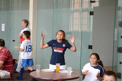 Cierra Adams, 10, left, Hummels Wharf, and Haylee Nava, 9, Selinsgrove, react while watching the World Cup match between the USA and Germany on Thursday at the Susquehanna University soccer camp.