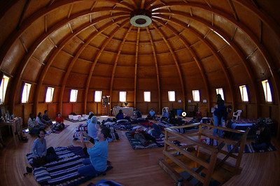 People preparing for a Sound Bath in the upper chamber of the Integratron.