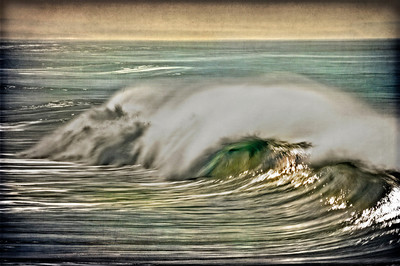 Breaking wave in Oceanside, California.Slow shutter speed, texture and retro look added.