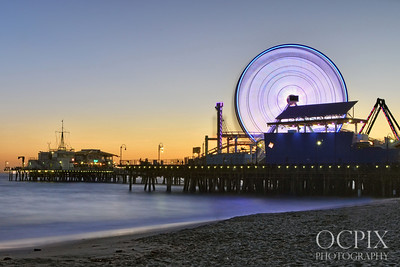 Santa Monica Pier at sunset with colorful ferris wheel lights