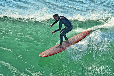 Surfer on the south side of the Huntington Beach Pier