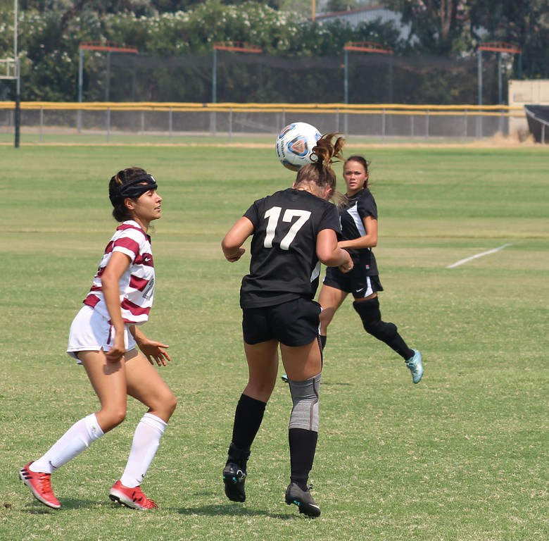 . Vehlilah Rothenberger (17) heads the ball upfield.