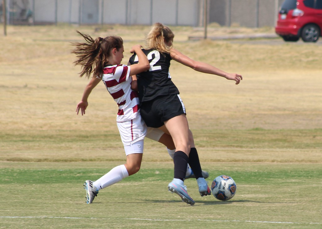 . Brooke Parks (22) beats a Sierra forward to the ball.