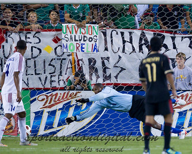 Cuba's goalkeeper Odelin Molina watches helplessly as the ball goes by his outstretched fingers.  Mexico vs Cuba in the first round of the Concacaf Gold Cup at Bank of America Stadium in Charlotte North Carolina, Mexico won 5-0