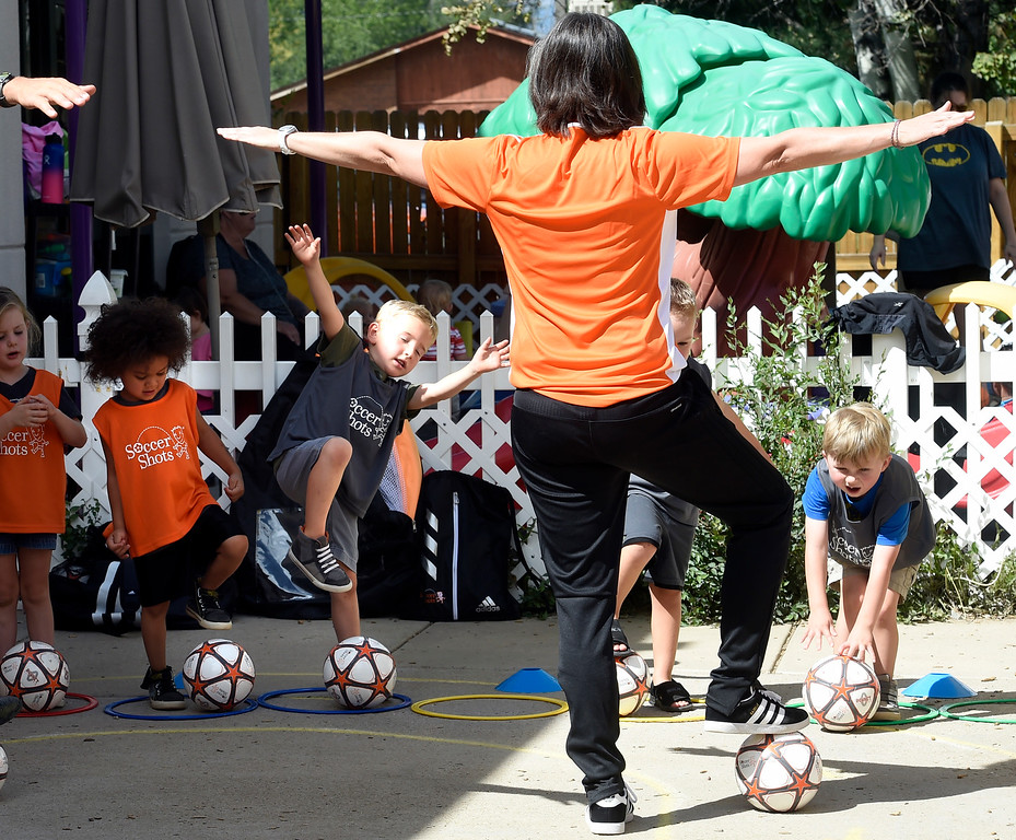 . LONGMONT, CO: August 30: Kingston Polk, left, Eli Honstien and Cayden Stratton, practice their soccer skills with coach Stephanie Seale at Soccer Shots in Longmont, CO on August 30, 2018. (photo by Cliff Grassmick/Staff Photographer).