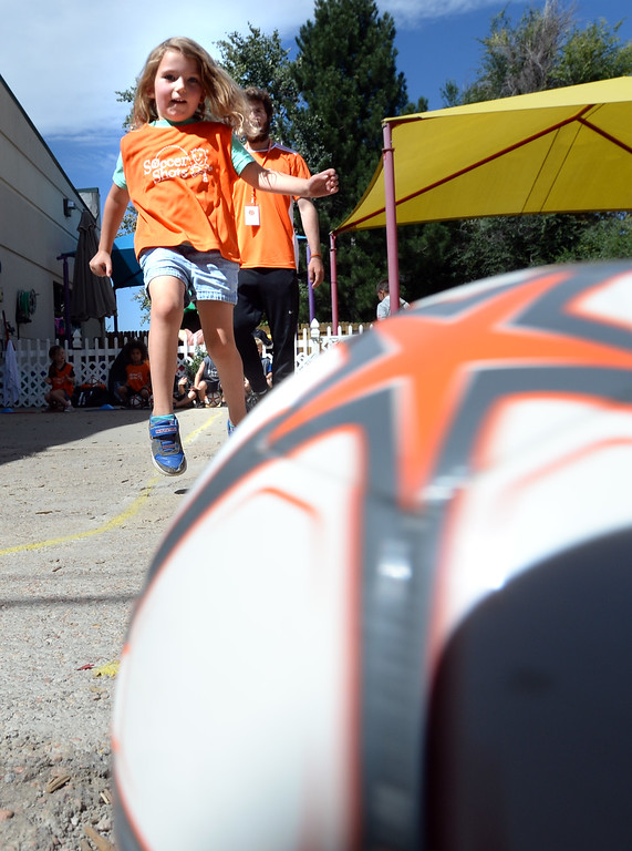 . LONGMONT, CO: August 30: Kenslie Matarese kicks the ball  at Soccer Shots in Longmont, CO on August 30, 2018. (photo by Cliff Grassmick/Staff Photographer).