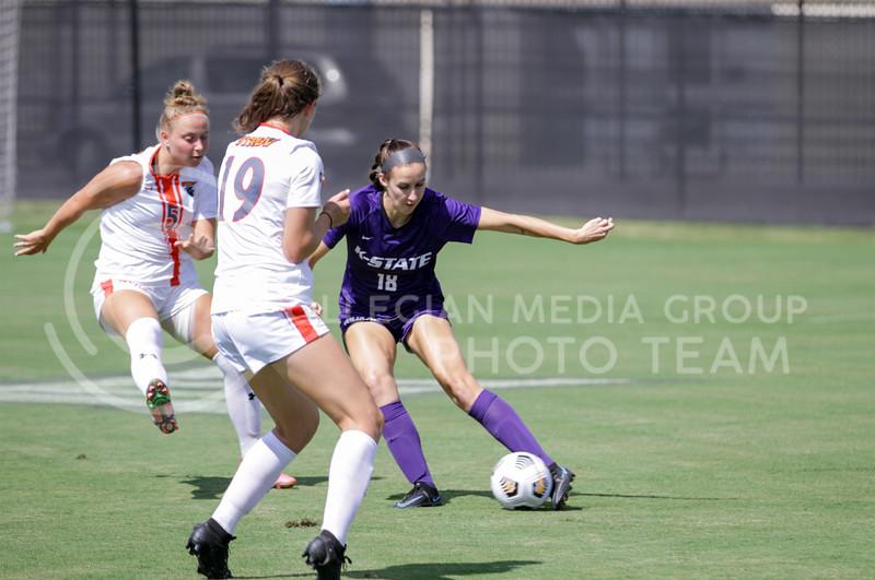 Senior Emily Crain goes past defenders during the September 19, 2021 game against UTRGV at Buser Family Park. (Sophie Osborn | Collegian Media Group)