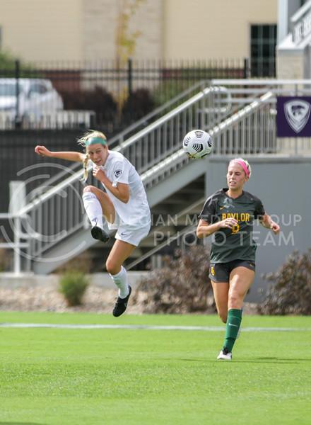 Junior Kursten Von Klahr leaps up to kick the ball past a defender during the October 10, 2021 game against Baylor. (Sophie Osborn | Collegian Media Group)
