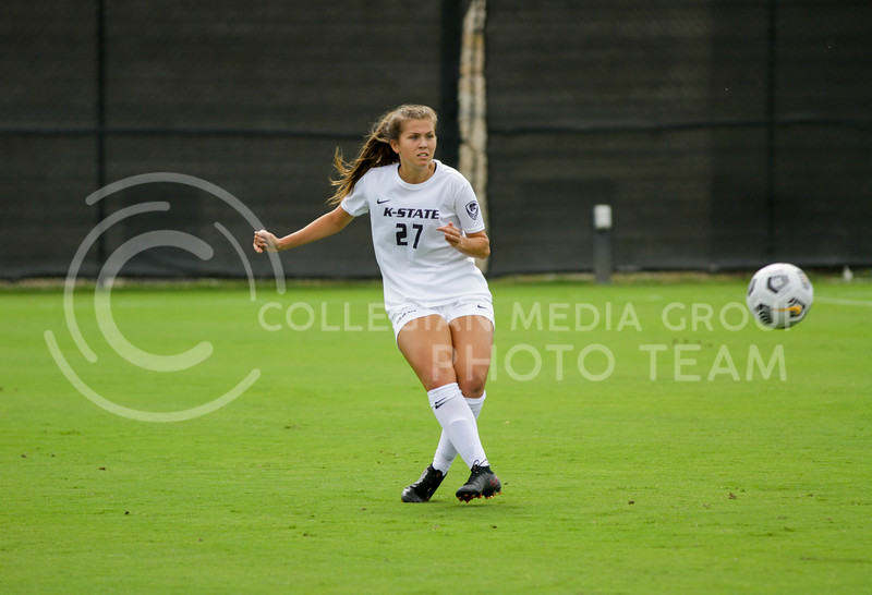 Sophomore Erin Morrissey kicks the ball to a teammate during the October 10, 2021 game against Baylor. (Sophie Osborn | Collegian Media Group)
