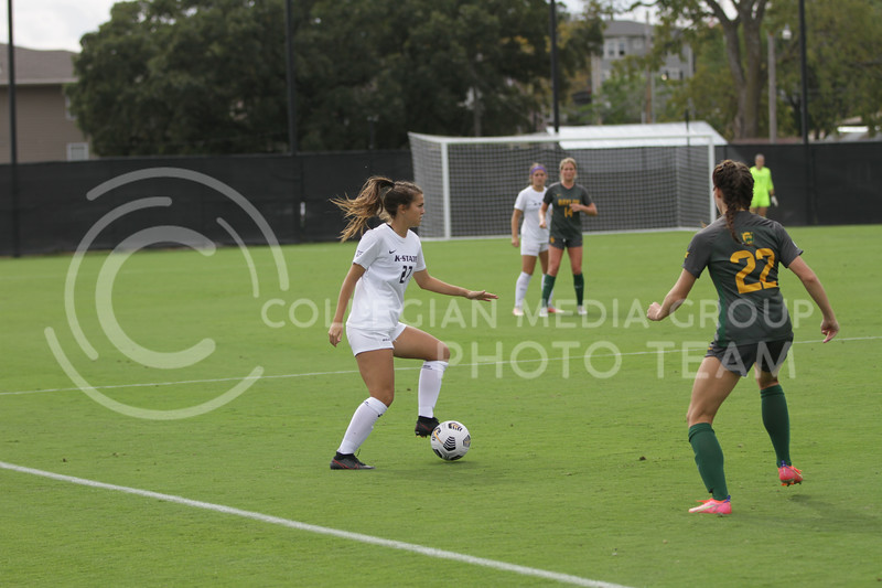 Sophomore Erin Morrissey looks to move the ball during the October 10, 2021 game against Baylor. (Sophie Osborn | Collegian Media Group)