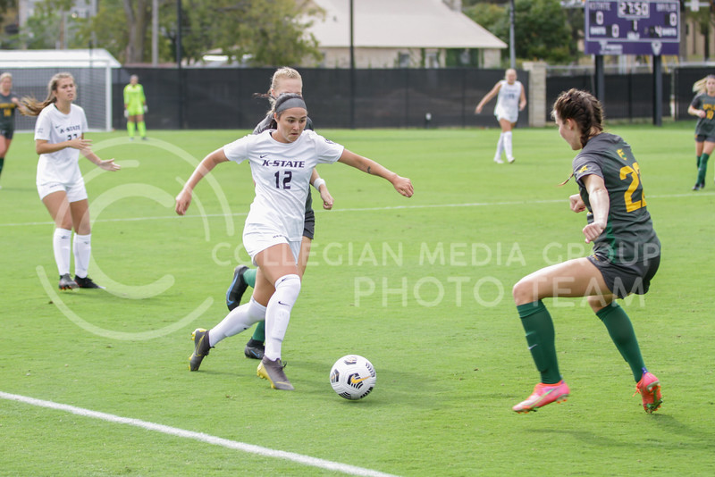 Junior Roo Yarnell-Williams kicks the ball away from an opponent during the October 10, 2021 game against Baylor. (Sophie Osborn | Collegian Media Group)