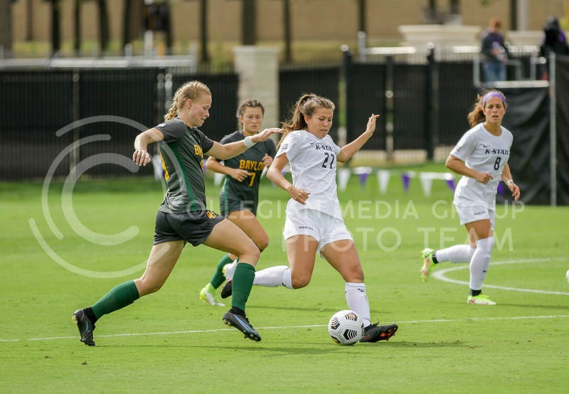 Sophomore Erin Morrisey prepares to kick the ball to a teammate during the October 10, 2021 game against Baylor. (Sophie Osborn | Collegian Media Group)