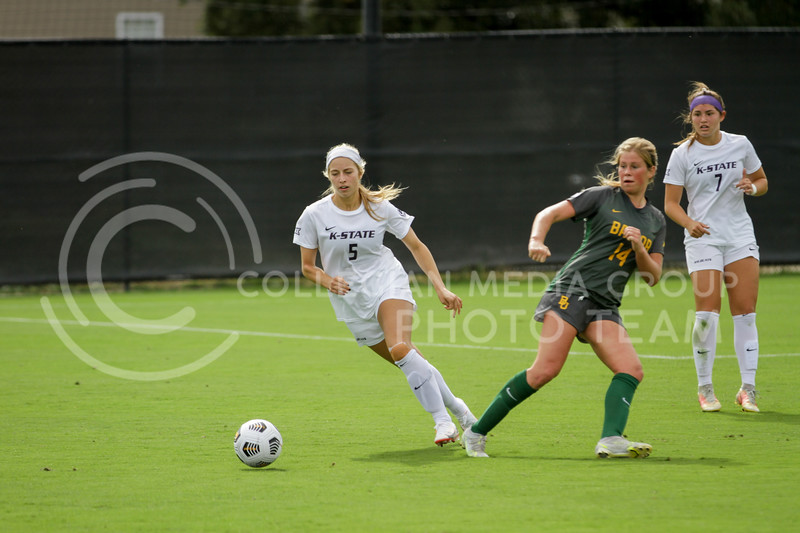 Sophomore Caylee Thornhill moves the ball away from a defender during the October 10, 2021 game against Baylor. (Sophie Osborn | Collegian Media Group)