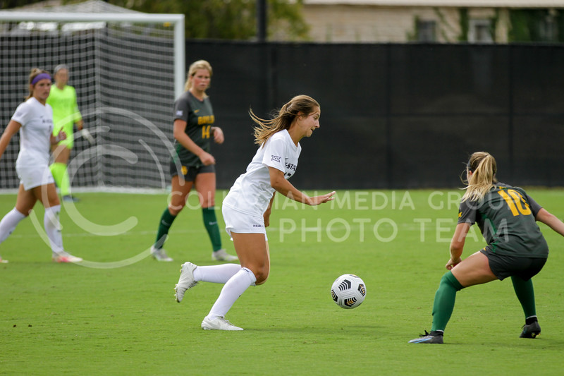 Junior Caylee Thornhill moves the ball past a defender during the October 10, 2021 game against Baylor. (Sophie Osborn | Collegian Media Group)