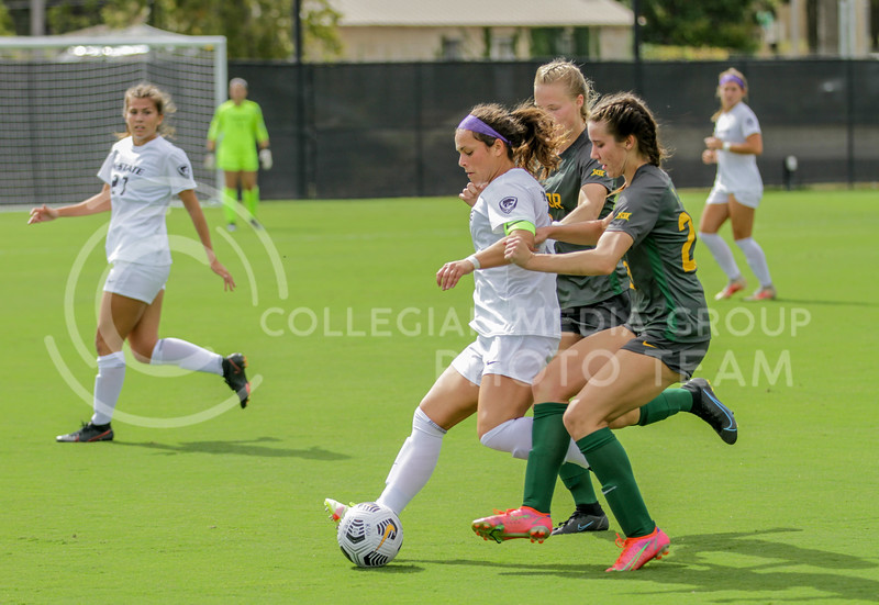 Graduate student Brooklyn Entz attempts to break through two defenders during the October 10, 2021 game against Baylor. (Sophie Osborn | Collegian Media Group)