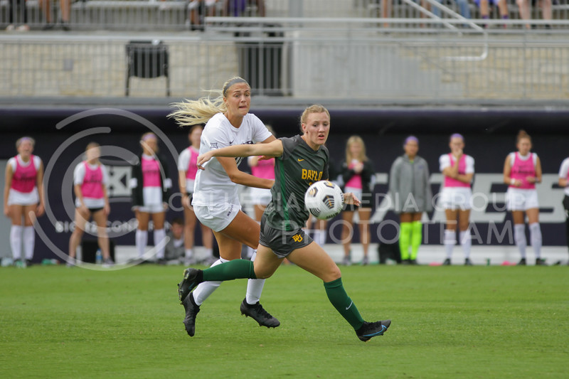 Junior Marisa Weichel eyes the ball during the October 10, 2021 game against Baylor. (Sophie Osborn | Collegian Media Group)