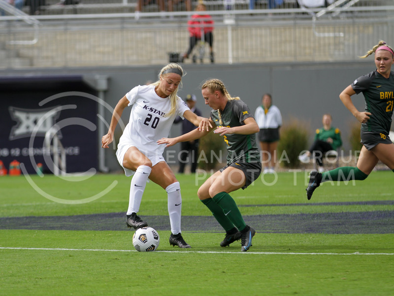 Junior Marisa Weichel attempts to keep the ball during the October 10, 2021 game against Baylor. (Sophie Osborn | Collegian Media Group)
