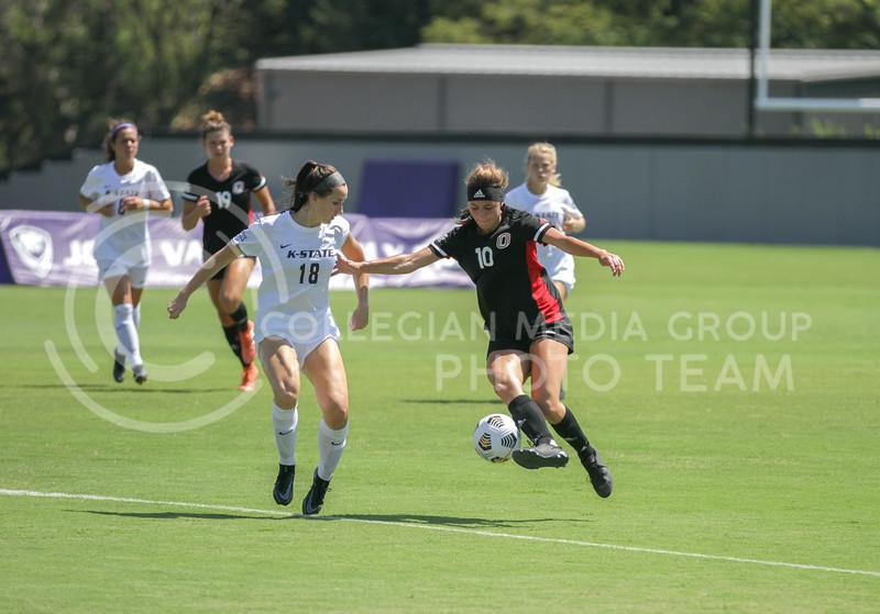 Senior defender Emily Crain runs alongside the ball during the August 22 game against Omaha at Buser Family Park. (Sophie Osborn   Collegian Media Group)