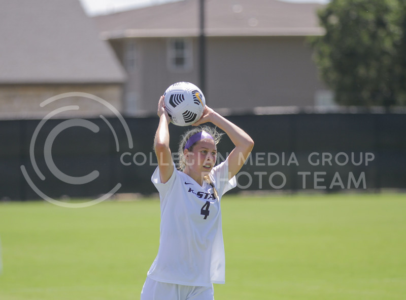 Junior Aliyah Al-Naggar throws the ball in from the sideline during the August 22 game against Omaha at Buser Family Park. (Sophie Osborn   Collegian Media Group)