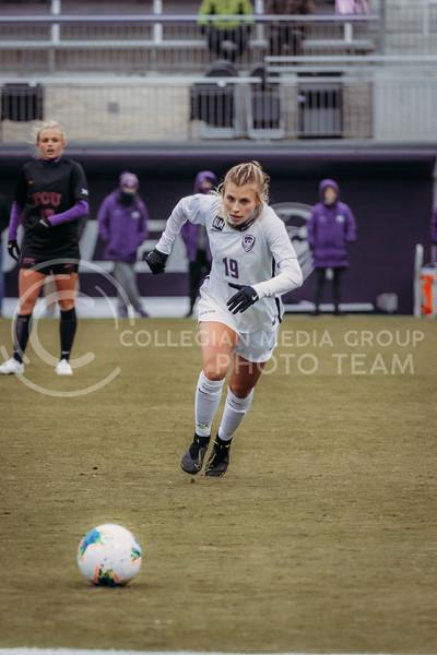 Senior midfielder Christina Baxter hustles towards the ball during the game against Texas Christian University on Oct. 25, 2020. (Sophie Osborn | Collegian Media Group)