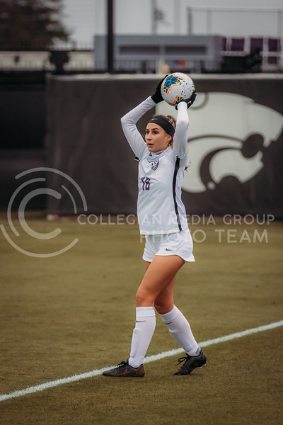 Junior defender Emily Crain looks for an open teammate to throw the ball to during the game against Texas Christian University on Oct. 25, 2020. (Sophie Osborn | Collegian Media Group)