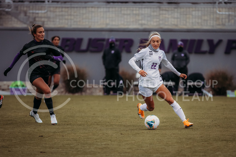 Freshman forward Maddie Weichel moves past an opponent during the game against Texas Christian University on Oct. 25, 2020. (Sophie Osborn | Collegian Media Group)