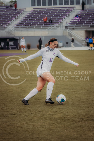 Senior defender Shelby Lierz  moves the ball down the field during the game against Texas Christian University on Oct. 25, 2020. (Sophie Osborn | Collegian Media Group)