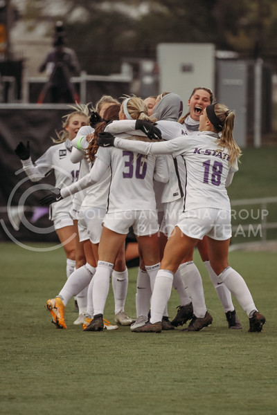 The team celebrates after scoring a goal during the game against Texas Christian University on Oct. 25, 2020. (Sophie Osborn | Collegian Media Group)