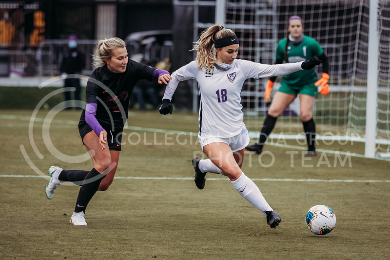 Junior defender Emily Crain looks to pass during the game against Texas Christian University on Oct. 25, 2020. (Sophie Osborn | Collegian Media Group)