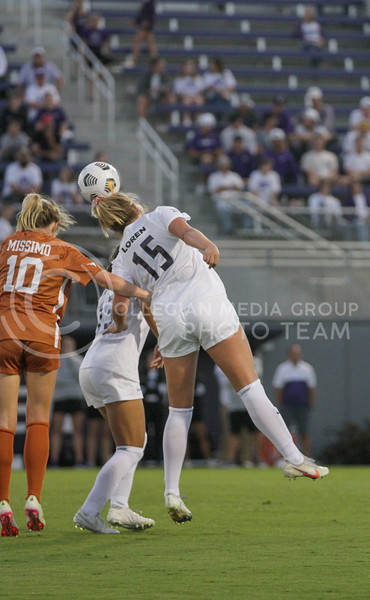 Junior Jesse Loren hits the ball of her head towards a teammate during the September 23, 2021 game against Texas. (Sophie Osborn | Collegian Media Group)