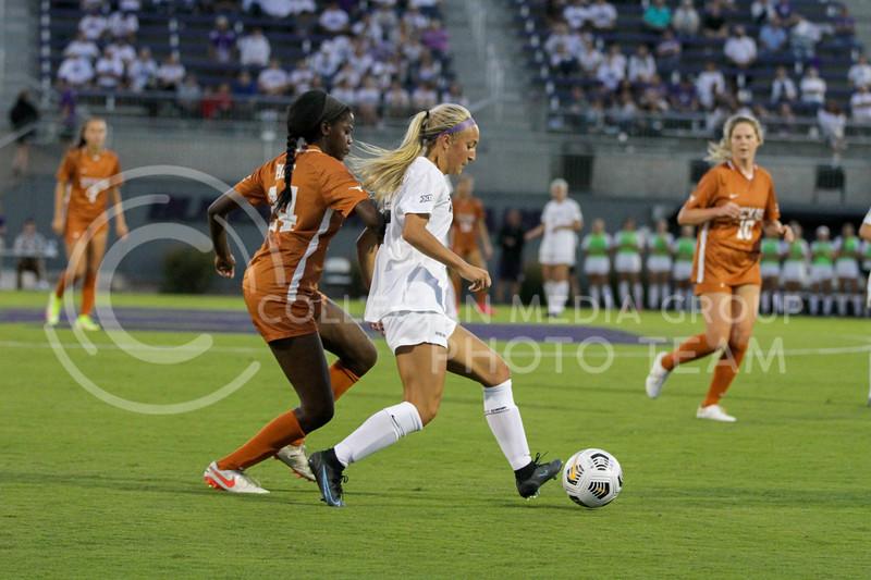 Junior Marissa Weichel kicks the ball down the field during the September 23, 2021 game against Texas. (Sophie Osborn | Collegian Media Group)