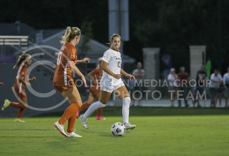Junior Bailey Nemechek moves the ball past a defender during the September 23, 2021 game against Texas. (Sophie Osborn | Collegian Media Group)