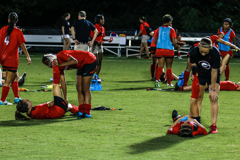 Members of the Georgia soccer team stretch after the Bulldogs' game with Samford at Turner Soccer Complex in Athens, Ga., on Friday, Aug. 26, 2016. (Photo by John Paul Van Wert)