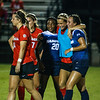 Members of the Georgia and Samford soccer teams embrace during the Bulldogs' game with Samford at Turner Soccer Complex in Athens, Ga., on Friday, Aug. 26, 2016. (Photo by John Paul Van Wert)