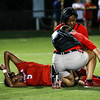 Georgia forward Kelsey Nix (5) is tended to by trainers during the Bulldogs' game with Samford at Turner Soccer Complex in Athens, Ga., on Friday, Aug. 26, 2016. (Photo by John Paul Van Wert)