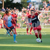 Sky BLue FC midfielder  Sarah Killion looking for an opportunity to steal the ball away from Spirit midfielder Christine Nairn.