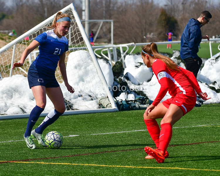 Penn State midfielders Laura Freigang looks for an opening to get the ball past Spirit team captain Shelina Zadorsky.