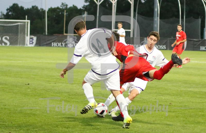 Hartford midfielder Alexis Triadis (20) Holy Cross Crusaders defender Ryan Gavey (14)