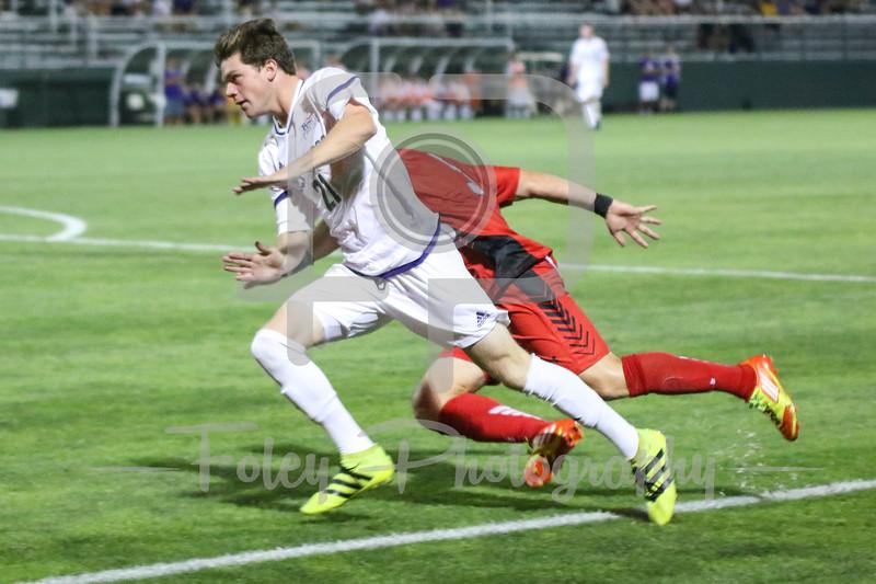 Holy Cross Crusaders forward/midfielder Tyler Bell (21) Hartford defender/midfielder Mike Barry (5)