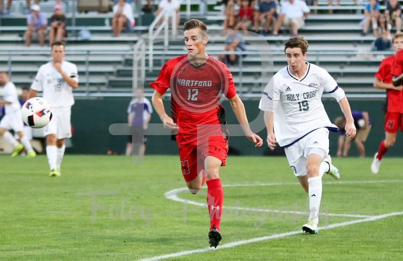 Hartford midfielder/defender Michael Balzan (12) Holy Cross Crusaders forward Matt Villano (19)