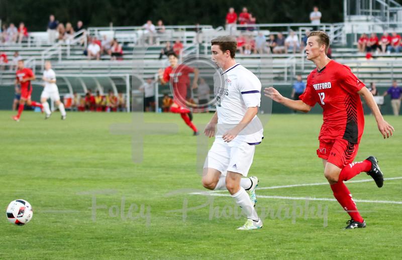 Holy Cross Crusaders forward Matt Villano (19) Hartford midfielder/defender Michael Balzan (12)