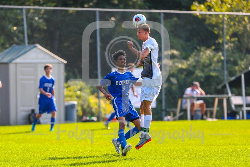 Nichols College Bison midfielder Corey McEvoy (21) Becker College Hawks midfielder Lemar Baptista (9)