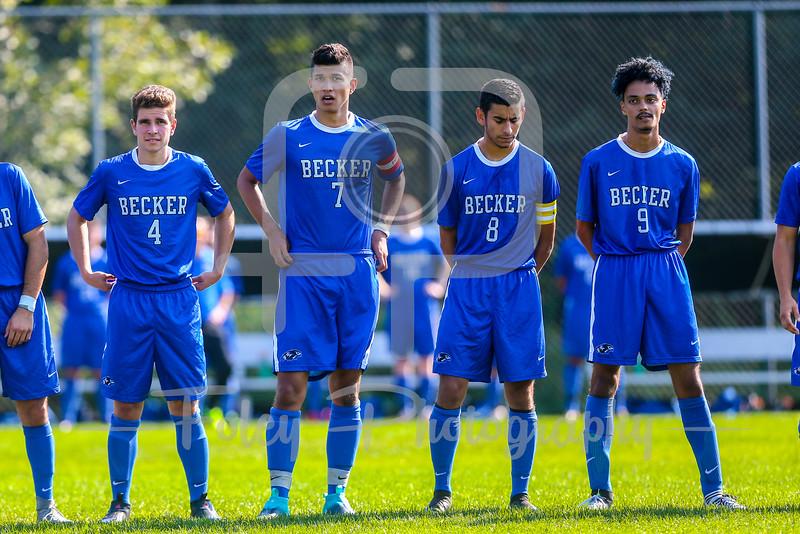 Becker College Hawks midfielder Lemar Baptista (9) Becker College Hawks midfielder Matthew Hillsberg (4), Becker College Hawks midfielder Cody Lavallee (7), and Becker College Hawks forward Nathan Cornejo (8)