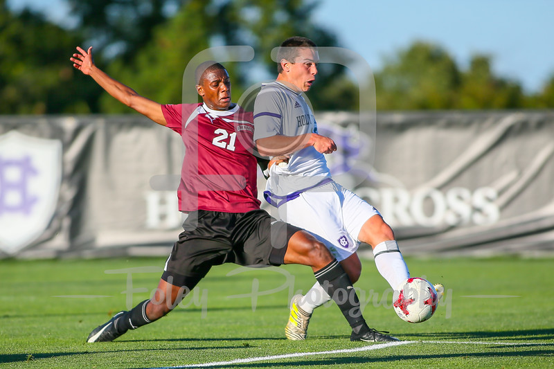 Sept. 29, 2017, Linda Johnson Smith Soccer Stadium, Worcester, MA: Holy Cross Crusaders Nichlolas Cestaro (13) takes a shot on goal with Lafayette Leopards Chris Moyse (21) right on him during the Crusaders 2-0 victory over the Leopards.