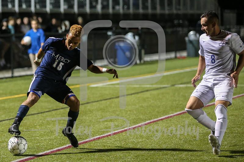 Mercy College Mavericks midfielder/forward Fredric Marcel (15)