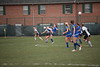 UF's Sage Schnell (11) tries to knock the ball down while  Rockhurst's Hannah Lauer (4) tries to kick it away.