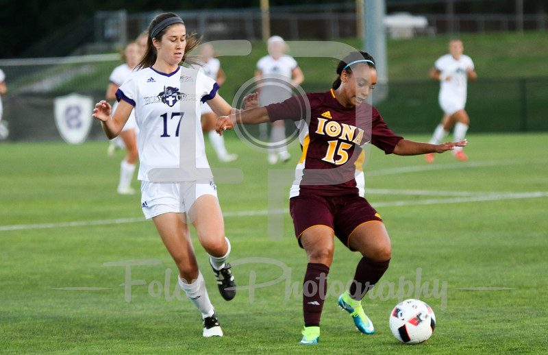 Friday, August 19, 2016; Worcester, Massachusetts;  Holy Cross Caitlin Hardy (17) chases after a ball with Iona Gaels Mariah Elsenheimer (15) also going after it during the Crusaders 3-1 victory.