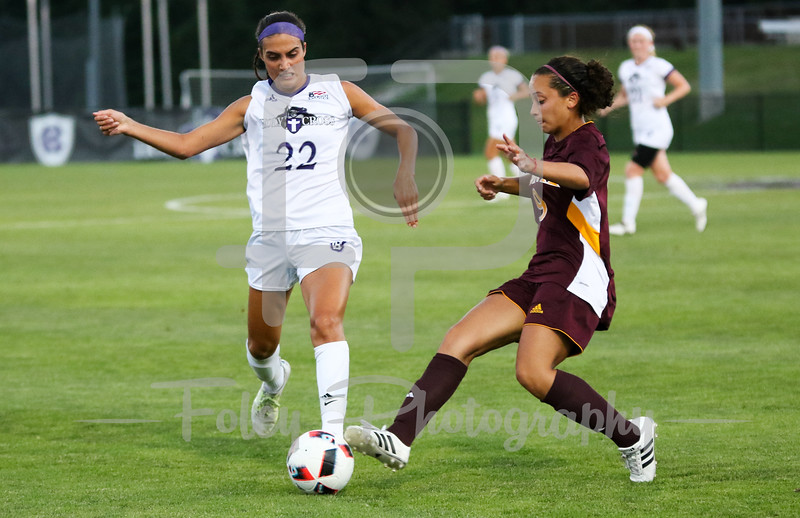 Friday, August 19, 2016; Worcester, Massachusetts;  Holy Cross Crusaders forward Christina Napolitano (22) tries to gets the ball but Iona Gaels forward Marisa Bentley (9) blocks it during the Crusaders 3-1 victory.