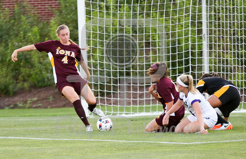 Friday, August 19, 2016; Worcester, Massachusetts;  Holy Cross Crusaders defender Allie Neumann (14) collides with Iona Gaels goalkeeper Tiffany Martinez (1) collide during the Crusaders 3-1 victory.