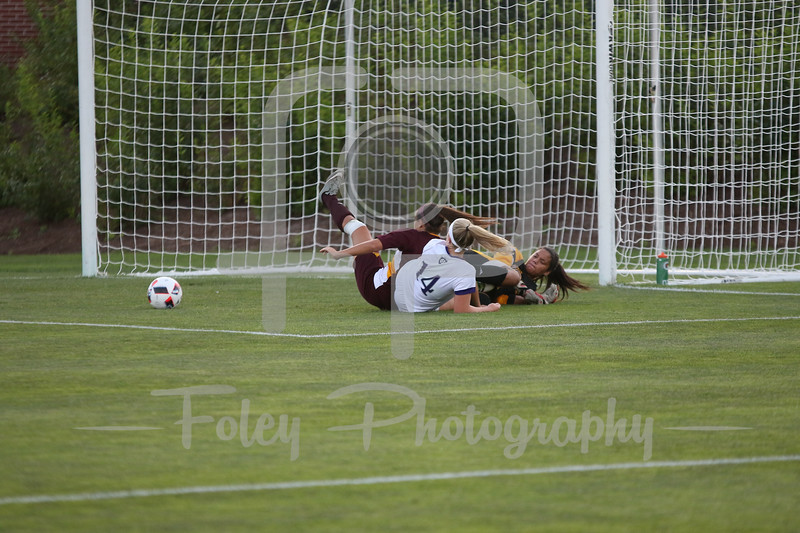 Iona Gaels goalkeeper Tiffany Martinez (1) Holy Cross Crusaders defender Allie Neumann (14)
